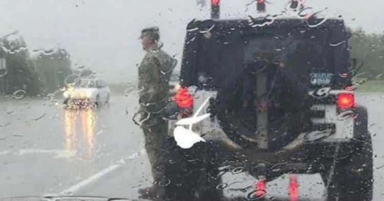 People Are Left In Tears After Realizing Why Solider Is Standing  At Attention In The Rain