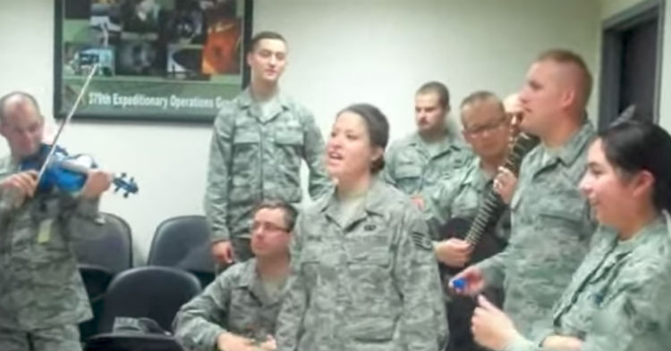 Nine Airmen Quietly Assemble In A Tiny Room, Now Keep Your Eyes On The Female In The Center