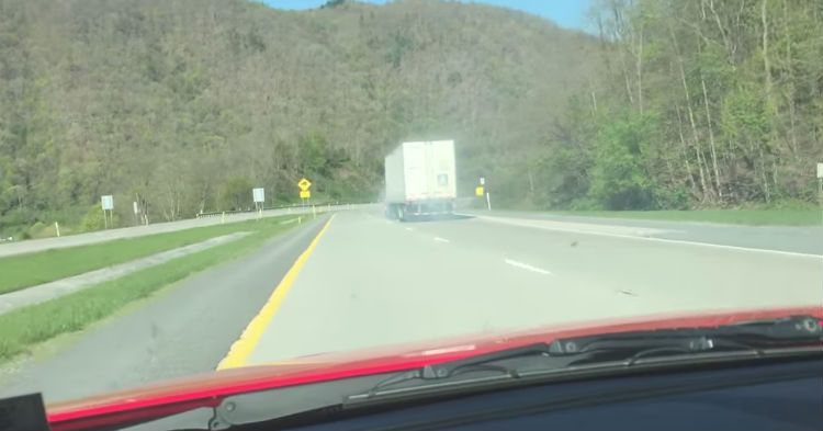Guy Spots Semi-Truck In Big Trouble, Speeds To Catch Up; Films Precision Driving