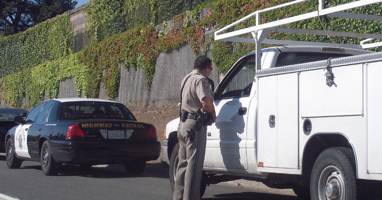 During Routine Traffic Stops, Cops Always Touch The Back Taillight. Here's The Reason Why